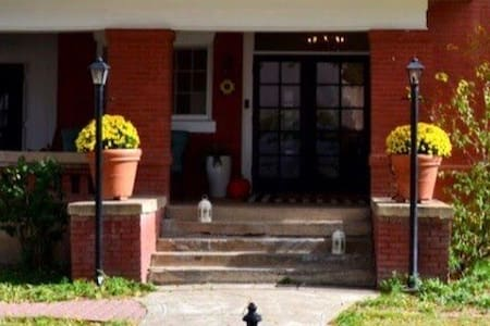 There are two lampposts that light up the entryway. There's also a porch light next to the front door.