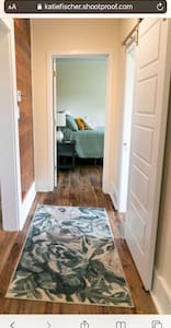 This short hall connects two bedroom with a bathroom between.