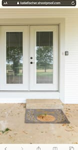 Double French doors in the side entrance.