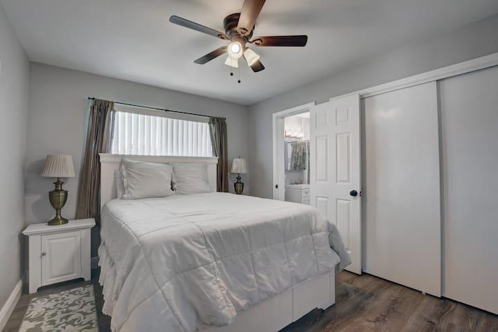 Bedroom #2 with queen set and door into 2nd bathroom