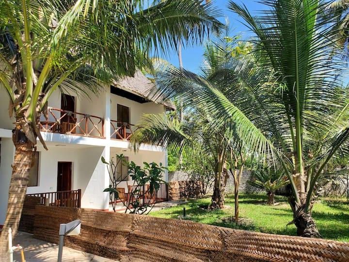 Beautiful beachfront apartment with garden