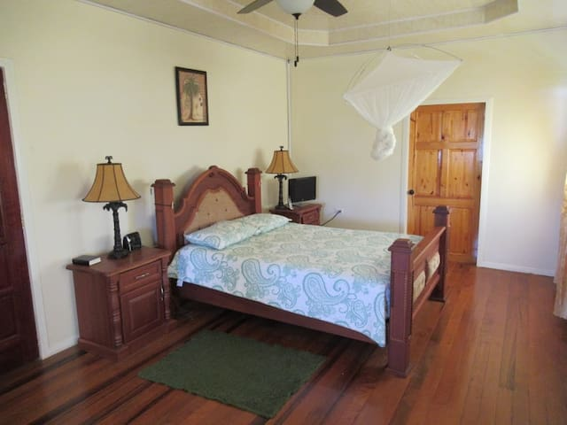 Sleep in comfort in this open and breezy master bedroom. Ceiling fan. Air conditioning.