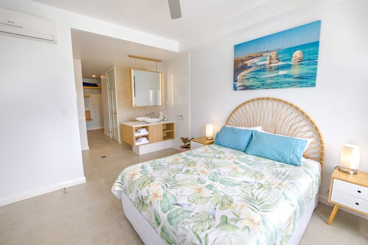 Enjoy the space in your open plan bedroom and ensuite.  TV and Aircon to every bedroom.