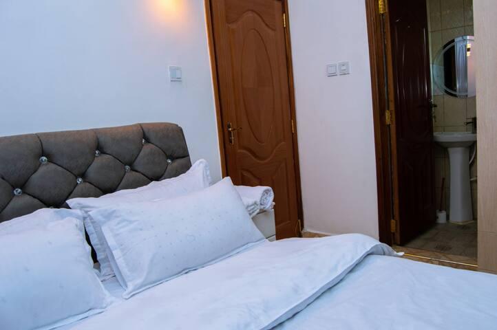 Spacious bed in ensuite bedroom