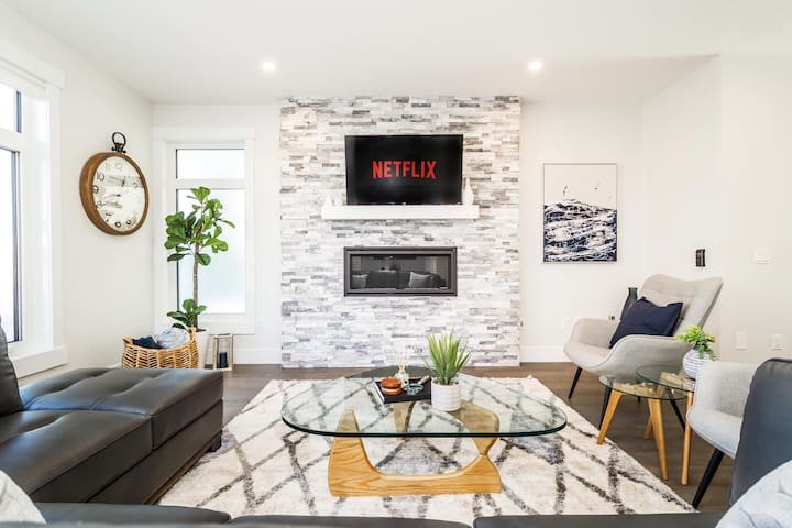 """Our living room features a gas fireplace and 50"""" Smart TV - complete with complementary Netflix to binge watch your favorite shows!  It's one of our favorite areas in our home to get nice and cozy."""