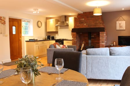 Cottage in rolling hills by the River Teme