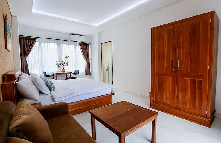 This is a 2 bedroom unit. The larger bedroom has a comfortable king size bed for 2 adults and a queen size (160 x 200 cm) sofa bed for 2 additional adults.  If there are additional guests, we will provide bedsheet, pillows and extra towels