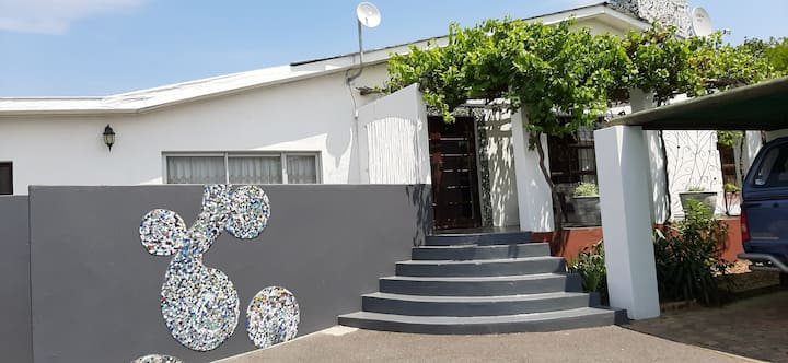 Mosaic flat with a view of the Helderberg