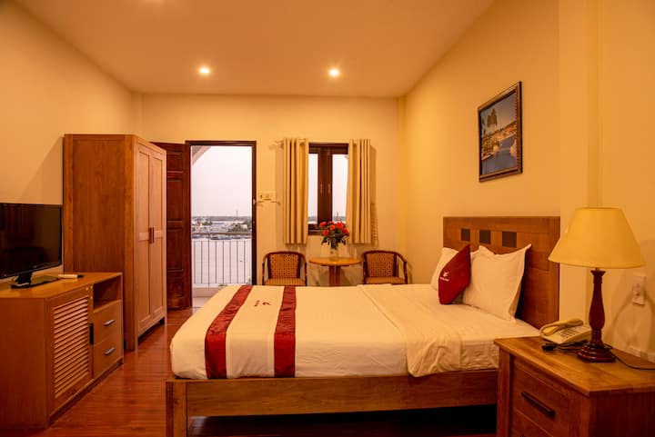 River-view  hotel double room with balcony