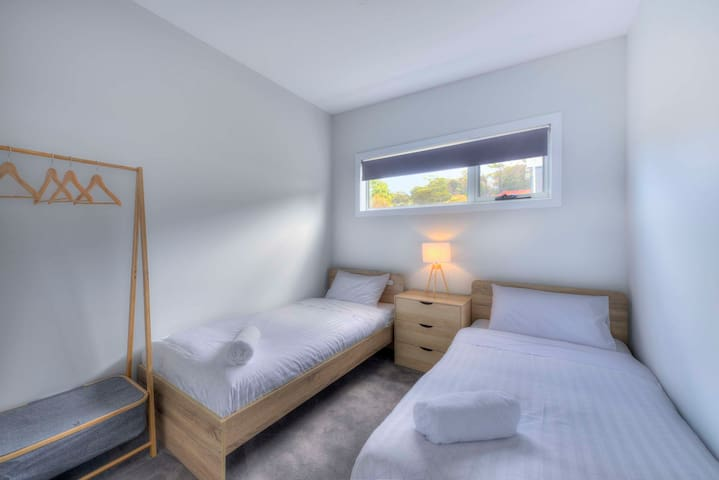 The third bedroom has two single beds
