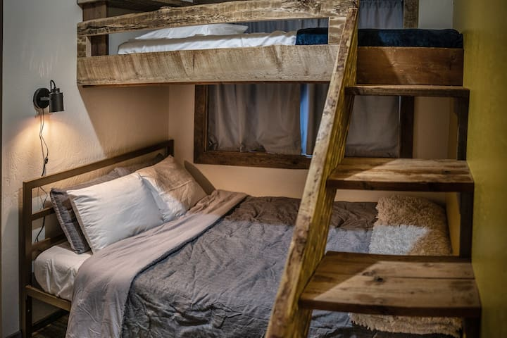 Second bedroom w/queen bed and top twin bunkbed. This room has beautiful large custom barn doors.