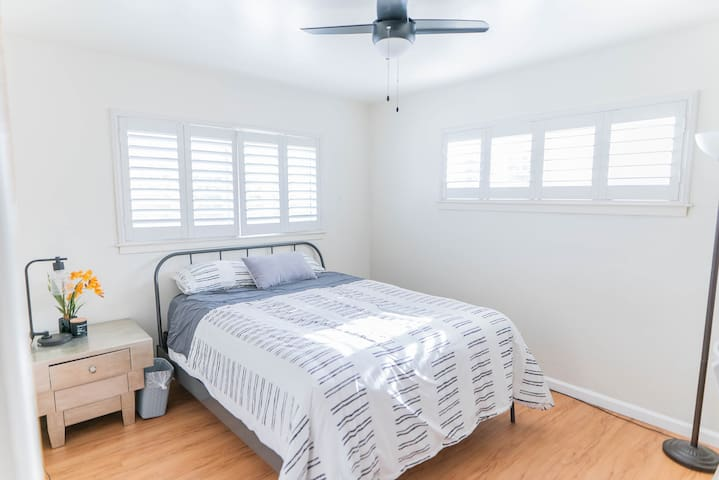 Room #3: Bedroom comes with comfy queen bed, nightstand, trash bin,  and a ceiling fan light that dims to your preference. This room also comes with a work desk and chair.
