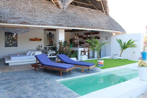 Penthouse Paje dengan kolam renang pribadi - 80 m ke pantai.