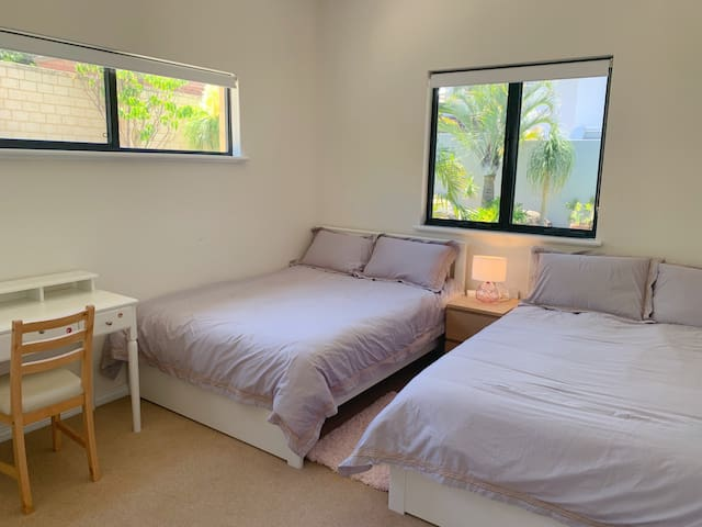 Bedroom 5 with two double beds