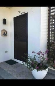 Main entrance door from open garage.
