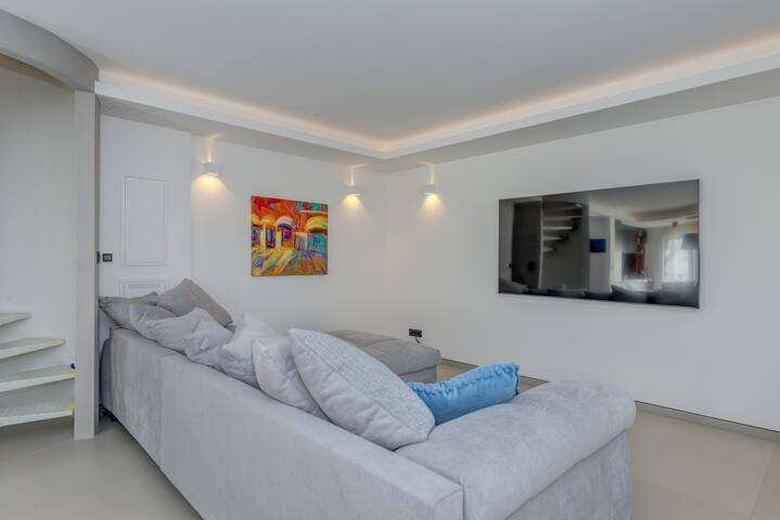 """Living Area with Huge Sofa Bed and 72"""" TV"""