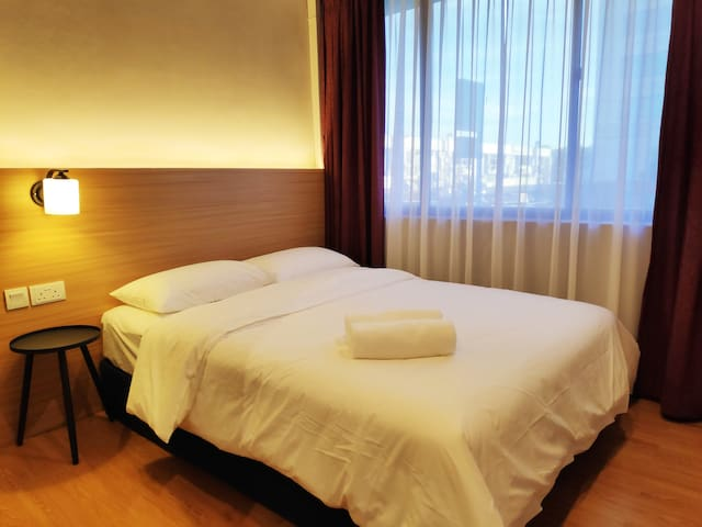 EZ Suites Queen bedroom - View of The Mall Gadong