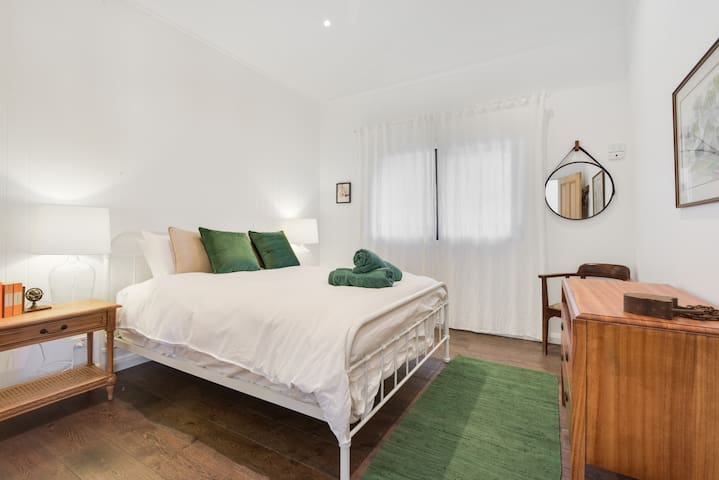 The Second queen bedroom is open and spacious with a fan, high ceilings and a comfy bed that will have you wanting to sleep in.
