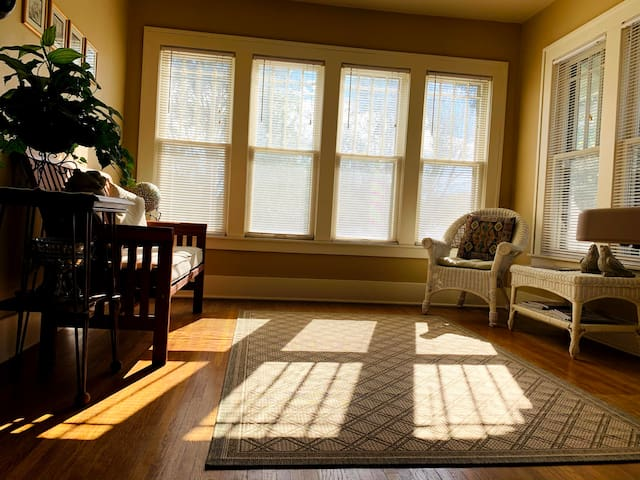Upstairs sunroom which can serve as an extra bedroom with an air mattress.