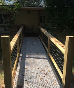 Ramp to the front porch from the parking area in front of the house.