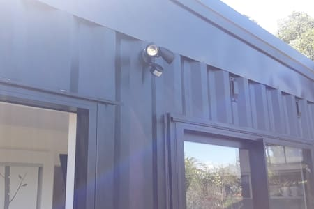 Security sensor lights from parking area to main entry