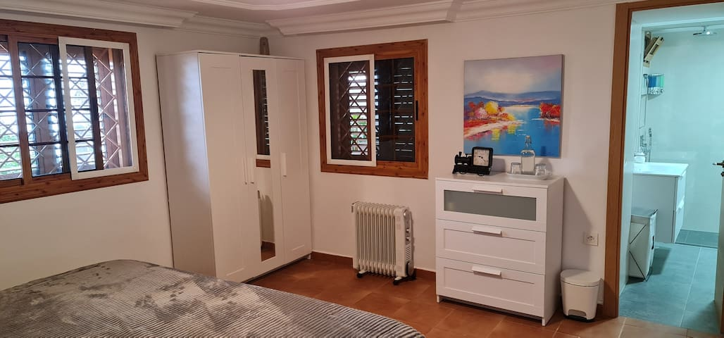 Teide guestroom bedroom with 2 double beds and with private bathroom.