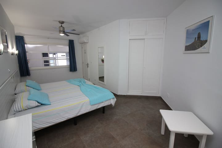 The spacious bedroom is equiped with ceiling fan and air conditioning. Also you'll find 2 big wardrobes and a chest of drawers