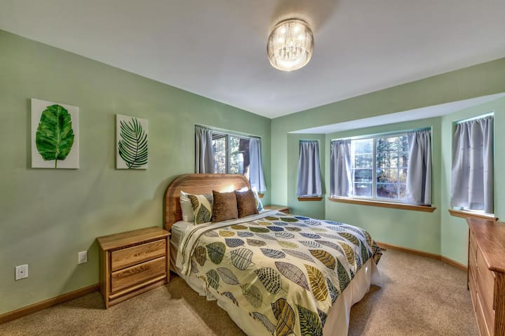 Downstairs bedroom 4 with a queen bed and calming leaf decor