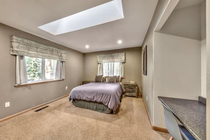 Upstairs bedroom 3 has a queen bed, skylight and desk space for anyone working or learning from home