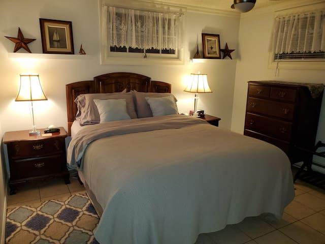 Bedroom 1:  Queen Bed, nightstands, dresser.