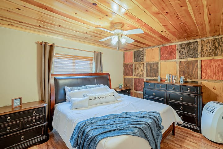 Charming downstairs bedroom with King Size bed, ceiling fan and portable heater if needed.