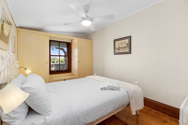 The two bedrooms feature antique wrought-iron Queen size beds in spacious surrounds.