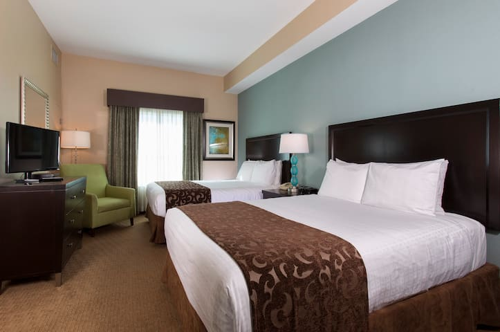 Bedroom with 2 queen beds and TV
