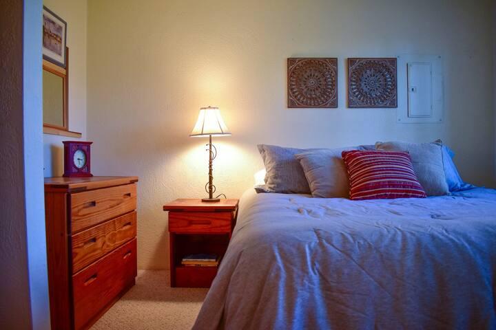 Queen bedroom offers closet and dresser space