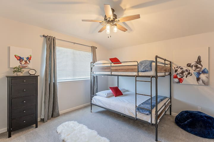 Whimsical third bedroom with full over full bunk bed.