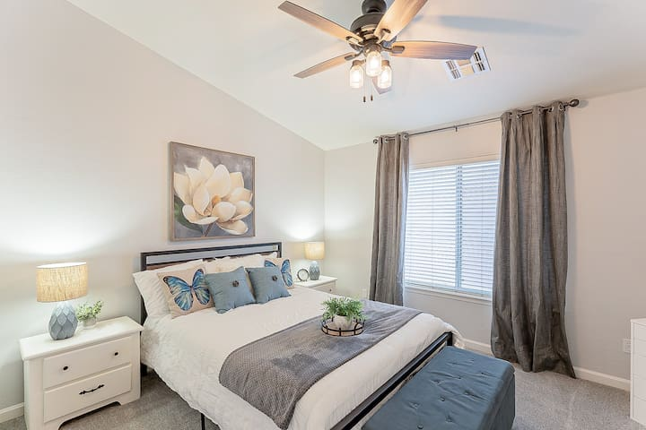 Bright lovely second bedroom with a queen bed for a peaceful nights rest.