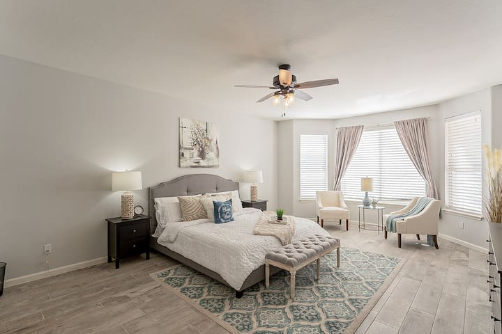 Opulent master bedroom with king bed and lots of extra touches for a luxurious stay.
