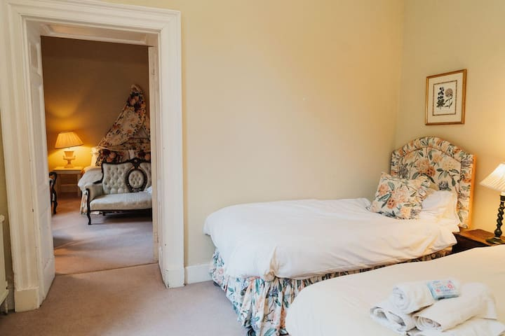 Peach room: twin - adjoining Rose, but with separate entrance; own en-suite bath with shower over