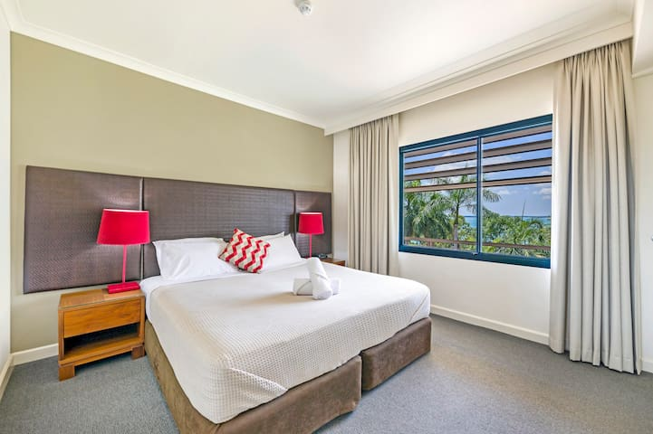 The master bedroom has a king-sized bed, large window with views, in-built wardrobes and an ensuite bathroom