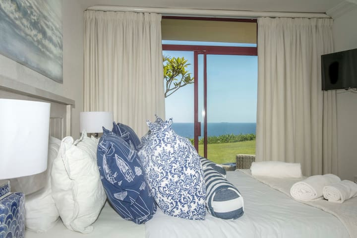 Master bedroom features direct access to the undercover patio.   Wake up to the beautiful view of the ocean