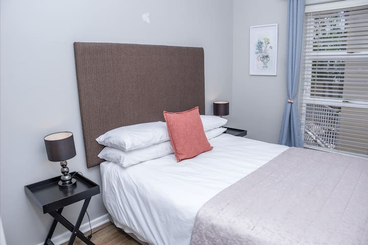 Middle bedroom with double size bed, spacious cupboard, facing shady trees