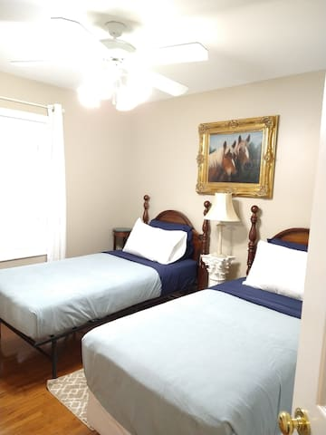 Horse room with two twin beds.