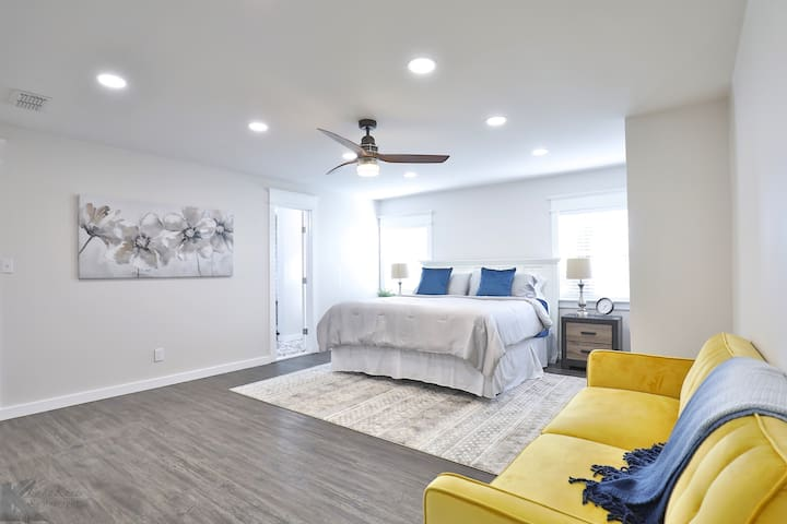 Luxurious Master Bedroom with a kingsize bed and a futon.