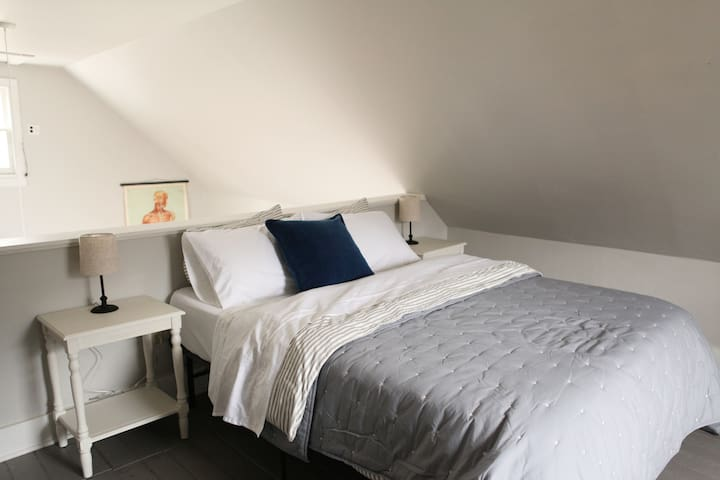 Upstairs open loft, a new queen sized bed with soft high thread count sheets, down comforter and soft organic quilt.  Lots of pillows too!