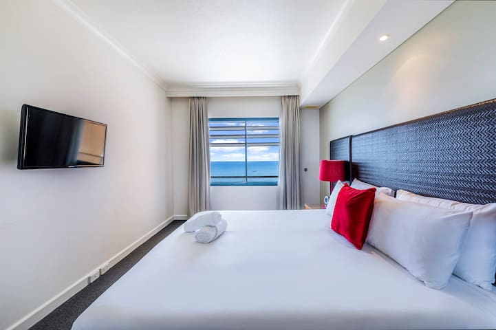 Fall asleep in the king bed knowing you'll wake up to blissful ocean views when you pull back the curtains in the morning...