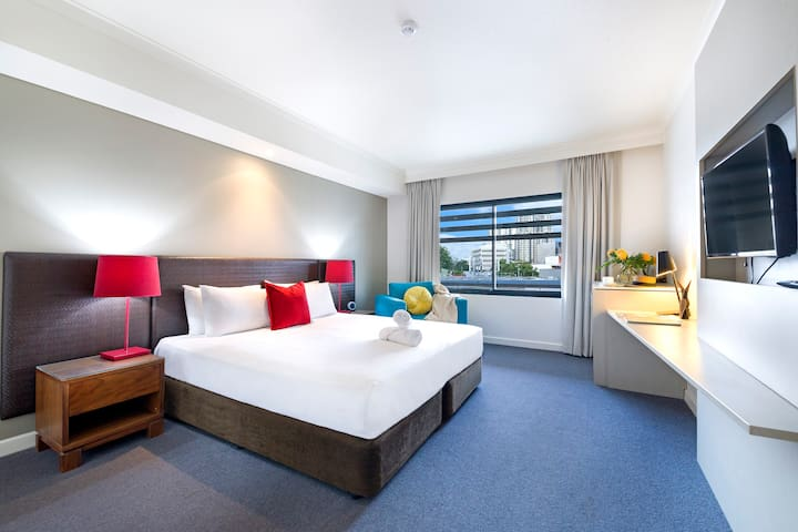 Unit 324 - An adjacent modern studio apartment offers up a comfortable king bed, television and its own ensuite bathroom