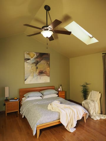 Master bedroom with skylight and a private balcony