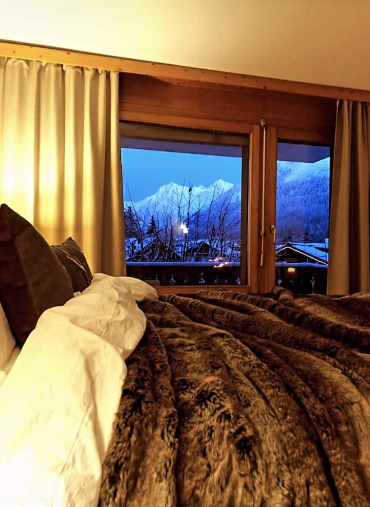 Central apt. in Klosters with mountain view & Spa