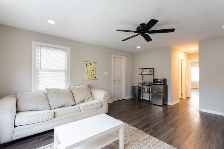 Private 1 Bedroom, 1 Bathroom Suite complete with a Living Area with a sofa, convenient kitchenette (includes a mini-fridge, microwave, electric kettle & dishes/silverware!), desk, W/D, AC, patio, backyard, & much more!