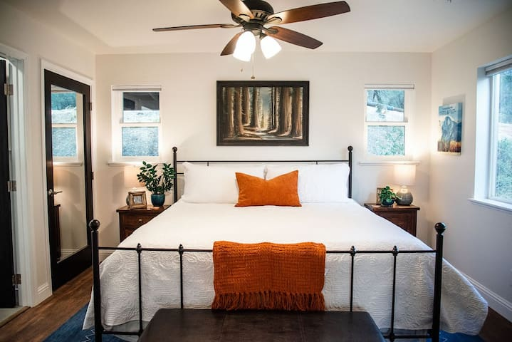 The pillow top king sized bed has plenty of pillows for relaxing and napping.